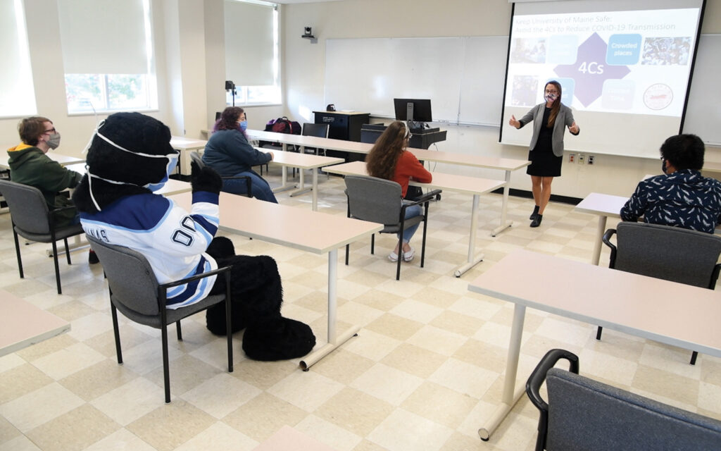 People socially distanced in a classroom