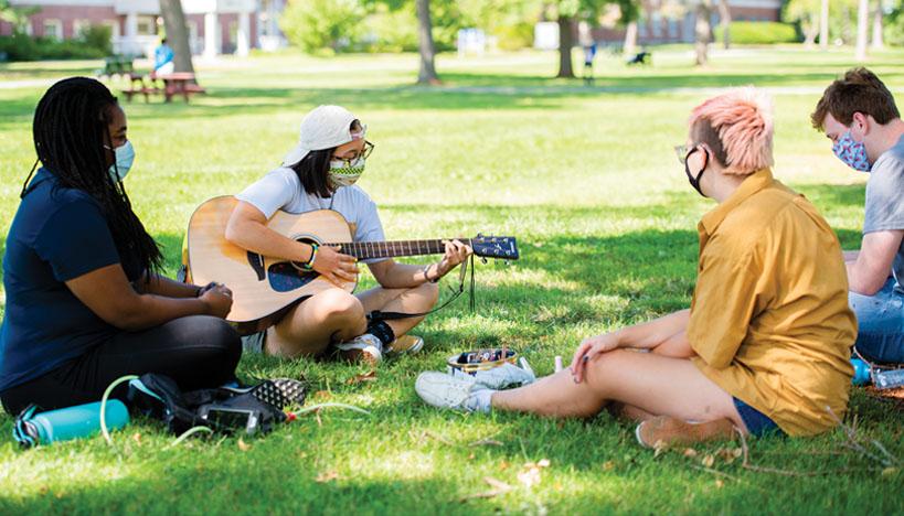 Students sitting on University Mall