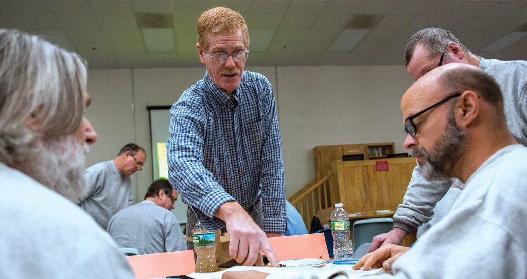 Mark Hutchinson instructs inmates