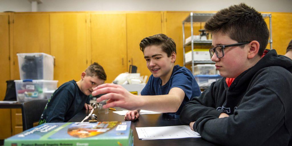 Boys running an experiment