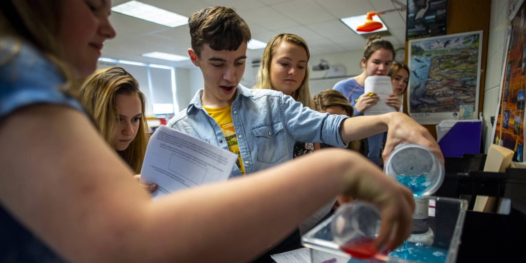 Students conduct an experiment
