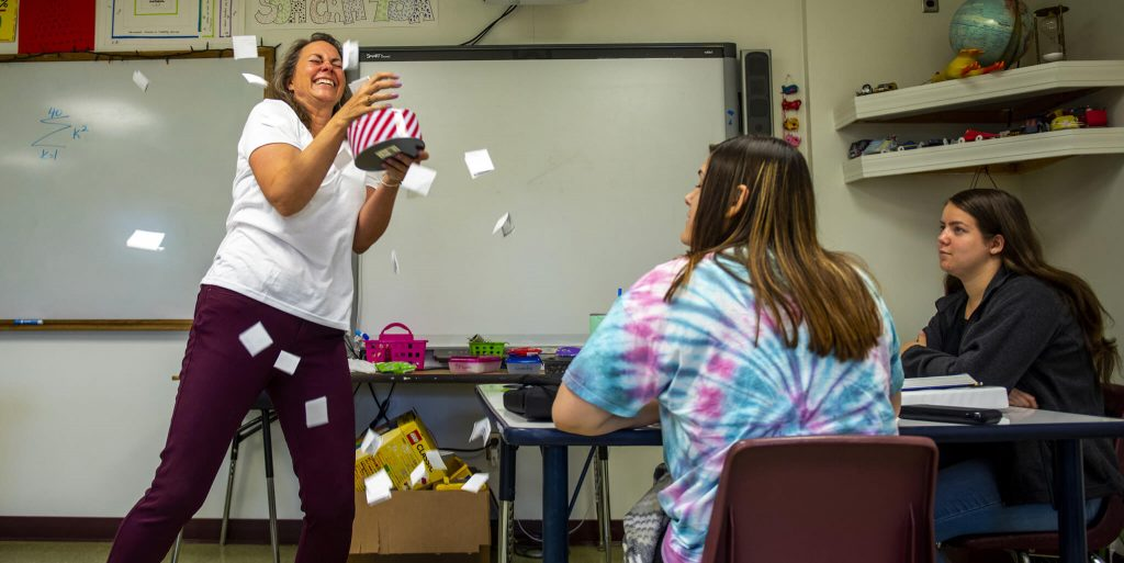 Teacher with cards flying