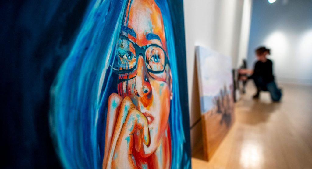 Art of woman with blue hair