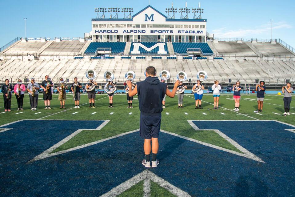 Rehearsal on the 50-yard line