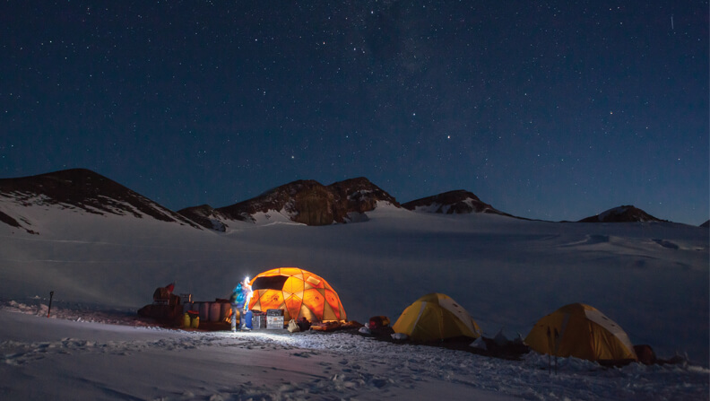 Tents in the snow at night