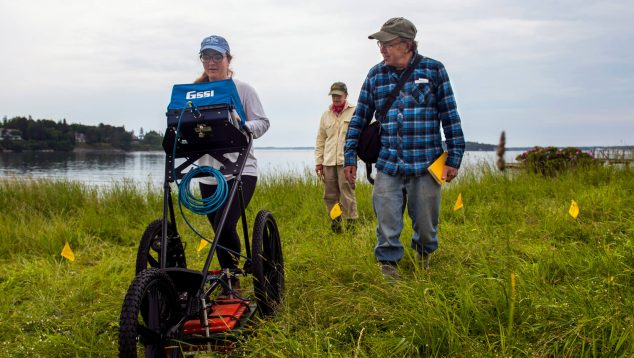 Researchers exploring a shell midden using GPR technology