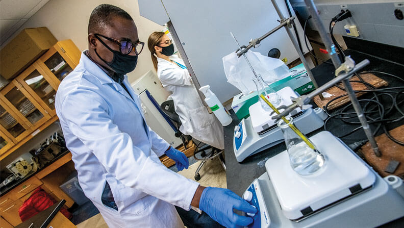 Students Bright Obeng and Bailey West in Associate Professor of Microbiology Julie Gosse lab conduct experiments with regard to their triclosan project.